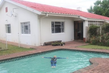 - 3019849 1 385x258 - This spacious family home, nestled in a quiet street in the suburb of Bergsig